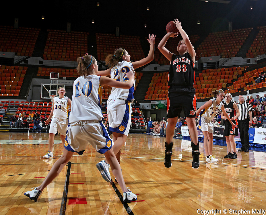 Waukon's Mary Halvorson (33) puts up a shot over MFL-MarMac's Chelsey Lamker (22) during their Rivalry Saturday game at the US Cellular Center in Cedar Rapids on Saturday January 2, 2010. Waukon defeated MFL MarMac 48-38 for Coach Gene Klinge's 939th career victory. (Stephen Mally/Freelance)