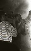 Shaun Ryder and Bez onstage at a Happy Mondays gig at the Free Trade Hall in Manchester in 1989.