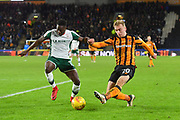 Barnsley FC defender Andy Yiadom (17) and Hull City forward Jarrod Bowen (20) during the EFL Sky Bet Championship match between Hull City and Barnsley at the KCOM Stadium, Kingston upon Hull, England on 27 February 2018. Picture by Ian Lyall.