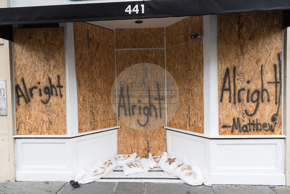 A boarded up shop on King Street in historic downtown after Hurricane Matthew passed through causing flooding and light damage to the area October 8, 2016 in Charleston, South Carolina. The hurricane made landfall near Charleston as a Category 2 storm but quickly diminished as it moved north.