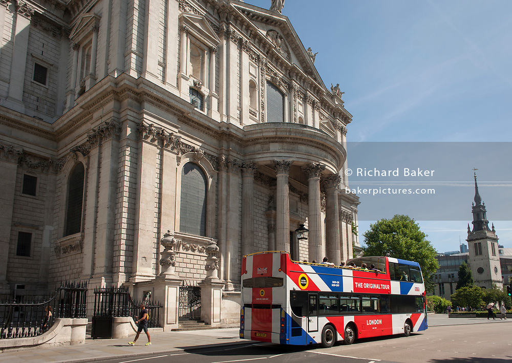 A tour bus with The Original Tour drives past the Sir Christopher Wren-designed St. Paul's Cathedral, on 7th July 2017, in central London.