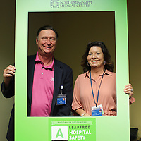 North Mississippi Medical Center Gilmore-Amory CEO Allen Tyra and chief nursing officer Cathy Mitchell pose behind a frame denoting the hospital's latest Leapfrog 'A' safety rating.