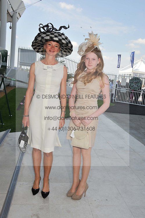 Left to right, the COUNTESS OF DERBY and her daughter LADY HENRIETTA STANLEY at the Investec Derby at Epsom Racecourse, Epsom Downs, Surrey on 4th June 2011.