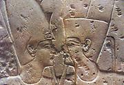 Amon facing an Egyptian Pharaoh.