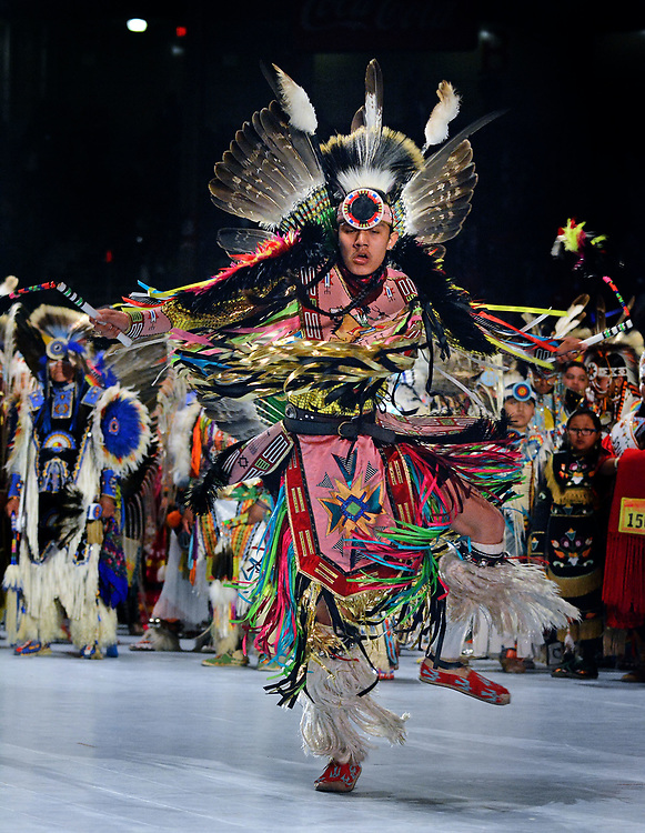 jt042817n/a sec/jim thompson/ Xavier Little Head of Lame Deer MT. dances as he introduced during the Grand Entrance at the 2017 Gathering of Nations Pow-Pow.  Friday April 28, 2017. (Jim Thompson/Albuquerque Journal)