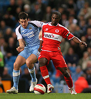Photo: Paul Thomas.<br /> Manchester City v Middlesbrough. The Barclays Premiership. 30/10/2006.<br /> <br /> George Boateng (R) and Man City's Joey Barton go for the ball.