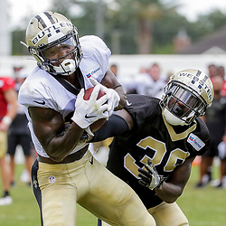 Jul 28, 2019; Metairie, LA, USA; New Orleans Saints wide receiver Emmanuel Butler (17) catches a pass over defensive back Kayvon Webster (39) during training camp at the Ochsner Sports Performance Center. Mandatory Credit: Derick E. Hingle-USA TODAY Sports