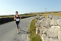 A weekend of glorious weather welcomed approximately 150 people from all over the country and abroad to Inis Mor , Arann Islands to participate in the annual Aer Arann half marathon.  Over the past ten years people have walked and ran the roads of Inis Mor to raise in excess of 1.2 million to purchase vital life saving equipment for sick children in both Crumlin and Temple Street hospitals.  Lisa  Cusack from Lucan in Dublin took part  . Photo:Andrew Downes.