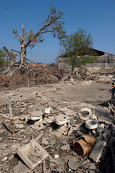 30 Sept, 2005.  New Orleans, Louisiana. Lower 9th ward. Hurricane Katrina aftermath.<br /> The remnants of the lives of ordinary folks, now covered in mud as the flood waters remain. Toilets are all that remain of the building that once surrounded them but was swept away in the floods. <br /> Photo; ©Charlie Varley/varleypix.com
