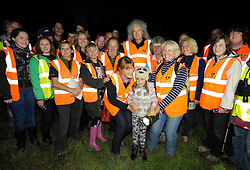 © Licensed to London News Pictures. 06/09/2013. Eldersfield, Gloucestershire, UK.  Brian May with Keeley age 6 from Tewkesbury and other campaigners on the Wounded Badger Patrol when he visited the badger culling zone in West Gloucestershire to lend support to the campaign against the cull.  Brian is an outspoken opponent of the badger cull and has a charity called Save Me.  The Government has licensed a pilot badger cull as part of efforts to reduce boving turberculosis in cows on farms.  06 September 2013.<br /> Photo credit : Simon Chapman/LNP