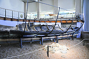 Remains of an ancient wood boat 2,400 years old found if the coast of Kibbutz Maagan Michael now housed at the Hecht Museum, University of Haifa, Israel
