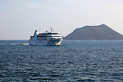 Armas ferry ship passing Los Lobos island, Corralejo, Fuerteventura, Canary Islands, Spain