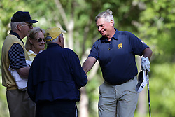 Jimmy Dunne talks to fans during the Chick-fil-A Peach Bowl Challenge at the Oconee Golf Course at Reynolds Plantation, Sunday, May 1, 2018, in Greensboro, Georgia. (Marvin Gentry via Abell Images for Chick-fil-A Peach Bowl Challenge)