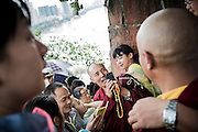 Two Buddhist monks take pictures during their visit to the Giant Buddha historical site in Leshan, Sichuan, China, August  9, 2014.<br /> <br /> Smartphones are an essential tool of Chinese ordinary life. Everywhere in China, people use them to take pictures to share online, to talk and chat, to play videogames, to get access to the mainstream information, to get connected one each other. In the country where the main global social media are forbidden - Facebook, Twitter and Youtube are not available  -, local social networks such as WeChat have a wide spread all over the citizens. The effect is an ordinary and apparently compulsive way to get easy access to digital technology and modern way of communication. <br /> A life through the display. Yes, We Chat.<br /> <br /> © Giorgio Perottino