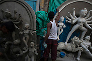 Artisans make Durga statues for the upcoming Durga Puya festival at Kumortuli market in Kolkata, West Bengal, India Saturday, Oct. 6, 2012 (Photo/Elizabeth Dalziel for Christian Aid)