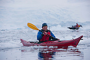 Dan, a tour guide, kayaking in Antarctica off the Scandinavian-built ice-breaker Akademik Sergey Vavilov, originally built for the Russian Academy of Science and still used occasionally by scientists, is now predominantly used for adventure touring in both the Arctic and the Antarctic. The ship is currently operated by a Russian crew, and staffed with employees of the adventure touring company Quark Expeditions, and carries around 100 passengers at a time. Skontorp Cove.