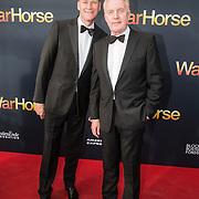 NLD/Amsterdam/20140614 - Inloop premiere Warhorse, Andre van Duin en partner Martin Elferink