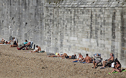 © Licensed to London News Pictures. 02/10/2015. Southsea, Hampshire, UK. People enjoying themselves in the sunny weather at the 'hot walls' in Old Portsmouth, Hampshire today, 2nd October 2015. The weekend weather is set to be dry and fine day in the south of England. Photo credit : Rob Arnold/LNP