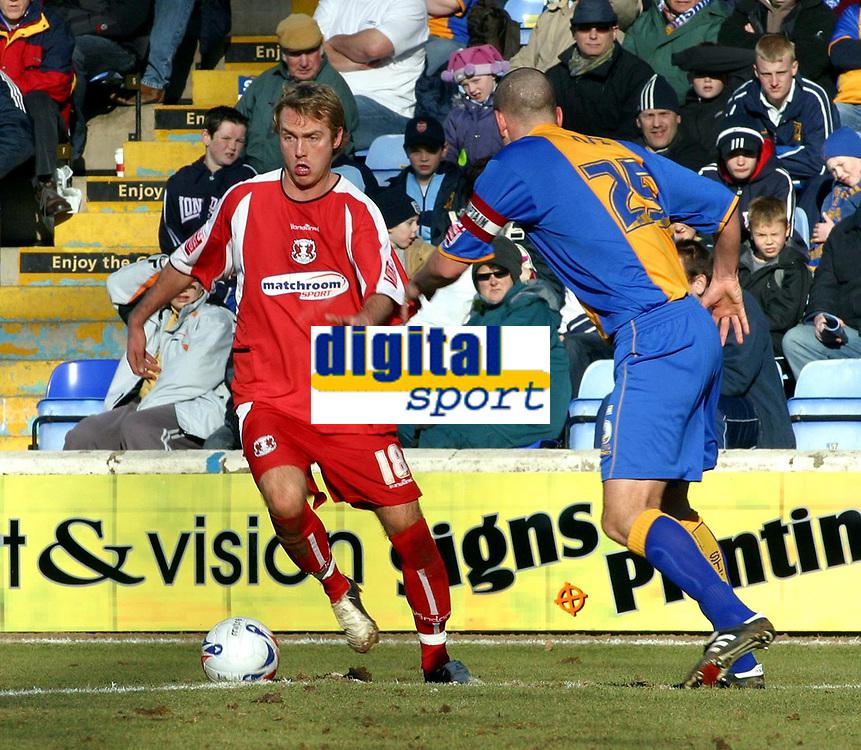 Photo: Dave Linney.<br />Shrewsbury Town v Leyton Orient. Coca Cola League 2. 04/03/2006.Orient's Neil Ashton on the ball