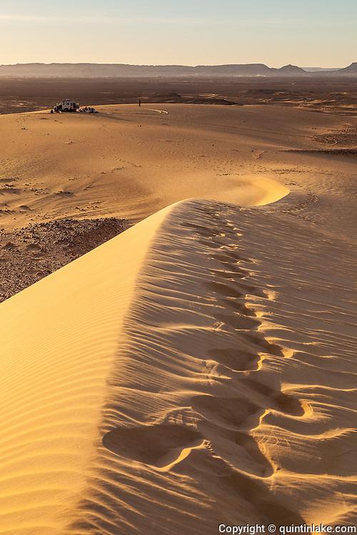 Footprints on a sand dune above camp near Bahariya Oasis, Western Desert, Egypt