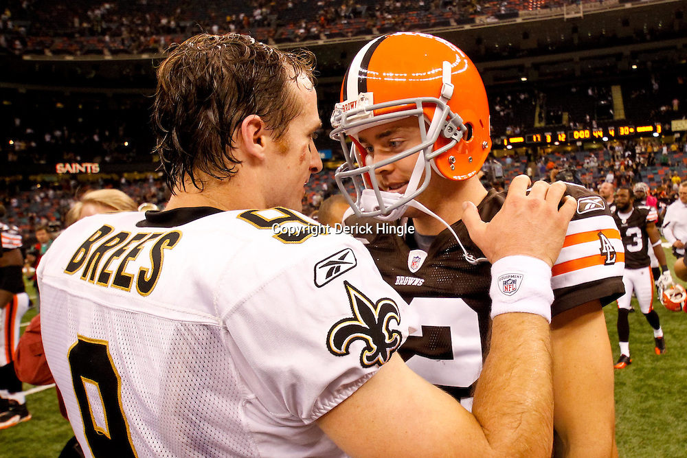 Oct 24, 2010; New Orleans, LA, USA; New Orleans Saints quarterback Drew Brees (9) talks with Cleveland Browns quarterback Colt McCoy (12) following their game at the Louisiana Superdome. The Browns defeated the Saints 30-17.  Mandatory Credit: Derick E. Hingle