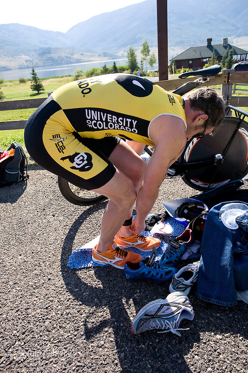 Male and female athletes competing in the Steamboat Triathlon in Steamboat Springs, Colorado change over from one portion of the triathlon to another.
