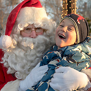 BRUNSWICK, Maine  11/24/18 -- Maddox Grondin, 6, of Litchfield, shares a smile with Santa at Brunswick's tree lighting event on Saturday.  <br /> Photo by Roger S. Duncan for the Forecaster