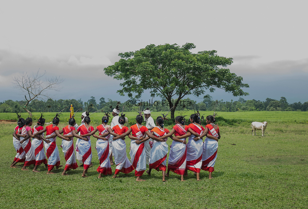 Women dancing the Jhumur, a typical traditional ritual dance, done before the seed sowing in Bormokuli village, about 45 km from Udalguri. Because of the bad roads it takes about 1 hour 20 mins to reach by vehicle from Udalguri. It is a very poor village in the middle of rice fields