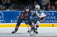 KELOWNA, CANADA - MARCH 25: Devante Stephens #21 of the Kelowna Rockets stick checks Garrett Pilon #41 of the Kamloops Blazers during second period on March 25, 2017 at Prospera Place in Kelowna, British Columbia, Canada.  (Photo by Marissa Baecker/Shoot the Breeze)  *** Local Caption ***