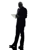 One Caucasian Senior Business Man holding digital tablet Silhouette White Background