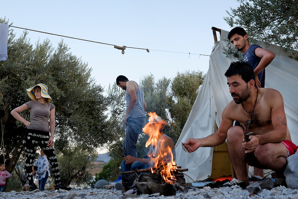 Lighting a fire for the night.<br /> Refugee camp Kara Tepe near Mytilene city. It hosts Syrian refugees who are waiting for their registration papers that will allow them to stay in Greece for some time till they can move to an other European country.