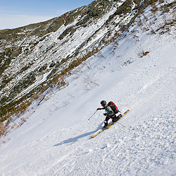 "Telemark skiing ""The Seven"" in the Great Gully on the headwall of King Ravine in New Hampshire's White Mountains.  King Ravine is a glacial cirque on the north side of Mount Adams.  Backcountry spring skiing."