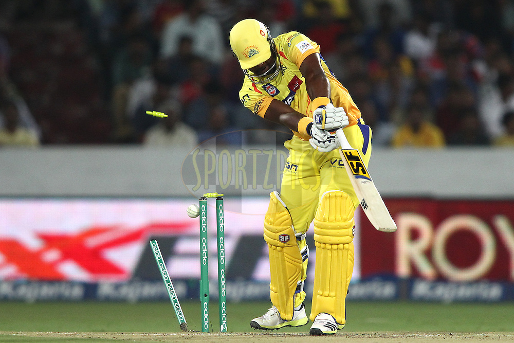 Dwayne Smith of the Chennai Super Kings is bowled by Parvinder Awana of the Kings XI Punjab during the second semi final match of the Oppo Champions League Twenty20 between the Kings XI Punjab and the Chennai Superkings held at the Rajiv Gandhi Cricket Stadium, Hyderabad, India on the 2nd October 2014<br /> <br /> Photo by:  Shaun Roy / Sportzpics/ CLT20<br /> <br /> <br /> Image use is subject to the terms and conditions as laid out by the BCCI/ CLT20.  The terms and conditions can be downloaded here:<br /> <br /> http://sportzpics.photoshelter.com/gallery/CLT20-Image-Terms-and-Conditions-2014/G0000IfNJn535VPU/C0000QhhKadWcjYs