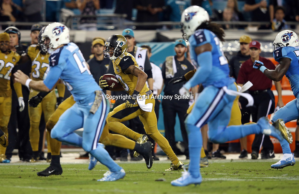 Jacksonville Jaguars wide receiver Rashad Greene (13) runs back a late fourth quarter punt 63 yards to the Tennessee Titans 5 yard line setting up the game winning score while Titans players give chase down the sideline during the 2015 week 11 regular season NFL football game against the Tennessee Titans on Thursday, Nov. 19, 2015 in Jacksonville, Fla. The Jaguars won the game 19-13. (©Paul Anthony Spinelli)