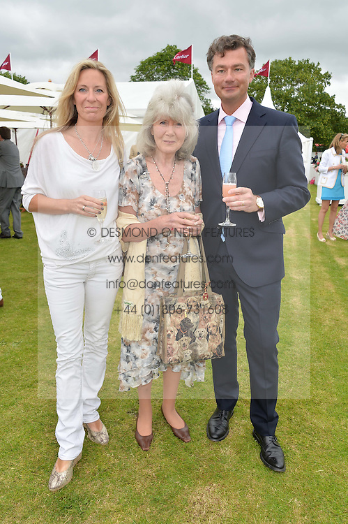 Left to right, EMILY COOPER, JILLY COOPER and LAURENT FENIOU MD of Cartier UK at the Cartier Queen's Cup Final polo held at Guards Polo Club, Smith's Lawn, Windsor Great Park, Egham, Surrey on 15th June 2014.