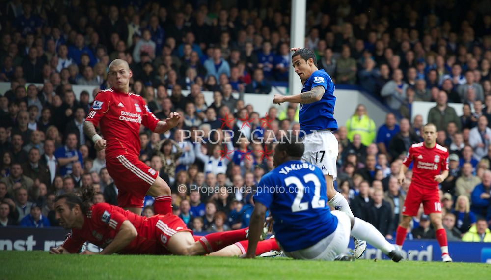 LIVERPOOL, ENGLAND - Sunday, October 17, 2010: Everton's Tim Cahill scores the first goal against Liverpool during the 214th Merseyside Derby match at Goodison Park. (Photo by Chris Brunskill/Propaganda)