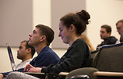 Students listen to and take notes during a learning community lecture on successful study habits in Schoonover Center on October 1, 2015. Photo by Emily Matthews