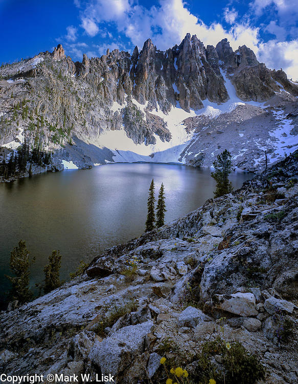 Heyburn Peaks reflect in the upper Bench Lake in Sawtooth Wilderness.