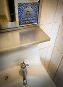 "A sticker reminds state park guests to ""Take Care of Texas"" by turning off the faucet at a Lake Arrowhead State park restroom on April 28, 2014. Lake Arrowhead State park is just south of Wichita Falls, Texas and the lake provides the town with drinking water."