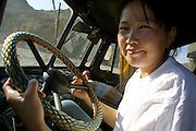 GOBI DESERT, MONGOLIA..08/29/2001.Near Mount Burkhan Khailaast. The cook steering the 4x4 kitchen truck of Nomads Tours..(Photo by Heimo Aga).
