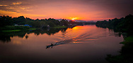 Sunrise on the River Kwai in Thailand on the famous bridge from the movie Bridge on the River Kwai.