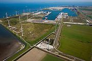 Nederland, Groningen, Eemshaven, 08-09-2009; havengebied Eemshaven, in beheer bij Groningen Seaports. De dijk rond de haven links wordt uitgerust met sensortechnologie om onderzoek te doen naar de sterkte en stabiliteit van dijken: dijkmonitoringssysteem LiveDijk (stichting IJkdijk). Windmolenpark met rechts aan de horizon de Eemscentrale, elektriciteitscentrale van Electrabel.Porth of Eemshaven, wind farm, with powerstation at the horiozn..The dike around tthe port (left) is equipped with sensor technology to research the strength and stability of dikes: dike monitoring system LiveDike.luchtfoto (toeslag); aerial photo (additional fee required); .foto Siebe Swart / photo Siebe Swart
