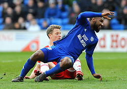 Ben Gibson of Middlesbrough tackles Junior Hoilett of Cardiff City- Mandatory by-line: Nizaam Jones/JMP - 17/02/2018 -  FOOTBALL - Cardiff City Stadium - Cardiff, Wales -  Cardiff City v Middlesbrough - Sky Bet Championship