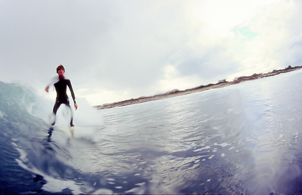 Yuri, an italian surfer from Tuscany, surfs a wave in Sardegna. Spring swell, La Punta spot.