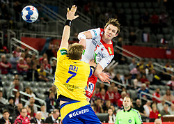 Sander Sagosen of Norway vs Max Darj of Sweden during handball match between National teams of Sweden and Norway on Day 7 in Main Round of Men's EHF EURO 2018, on January 24, 2018 in Arena Zagreb, Zagreb, Croatia.  Photo by Vid Ponikvar / Sportida