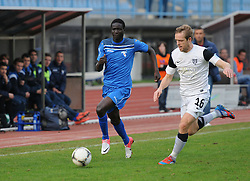 Ndiaye Welle #25 of Gorica vs. Jure Travner #16 of Mura 05 during football match between ND Gorica and ND Mura 05 in 20th Round of PrvaLiga NZS 2012/13 on November 24, 2012 in Nova Gorica, Slovenia. (Photo By Ales Cipot / Sportida).