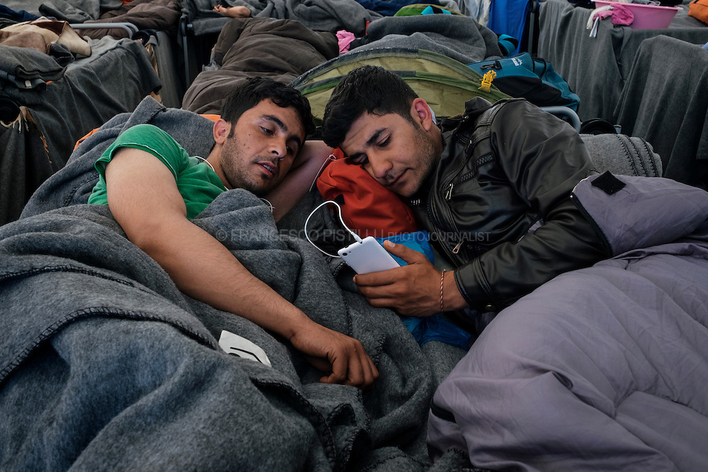 Two Syrian patients sharing the same bed at MSF First-aid tent, Idomeni Refugee Camp.