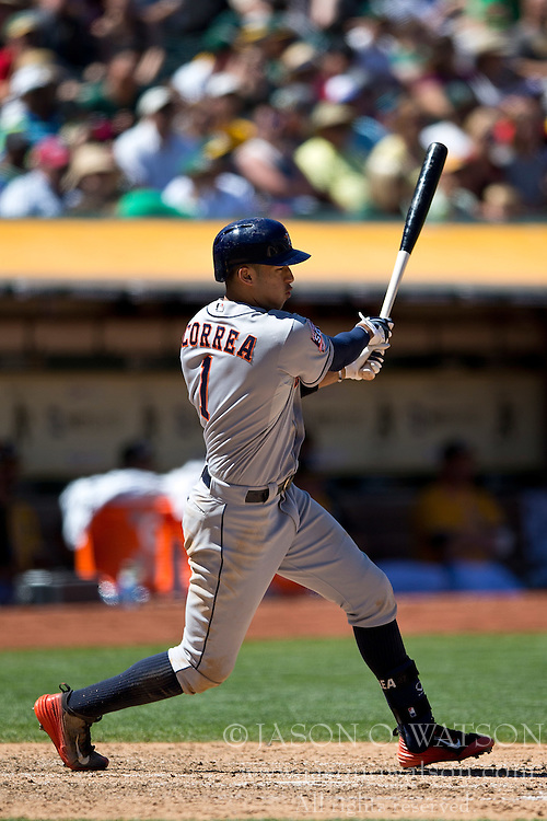 OAKLAND, CA - AUGUST 09:  Carlos Correa #1 of the Houston Astros at bat against the Oakland Athletics during the sixth inning at O.co Coliseum on August 9, 2015 in Oakland, California. The Oakland Athletics defeated the Houston Astros 5-4. (Photo by Jason O. Watson/Getty Images) *** Local Caption *** Carlos Correa