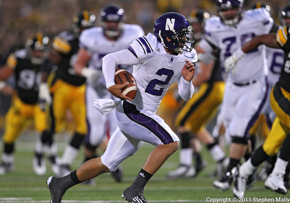 October 15, 2011: Northwestern Wildcats quarterback Kain Colter (2) on a run during the first half of the NCAA football game between the Northwestern Wildcats and the Iowa Hawkeyes at Kinnick Stadium in Iowa City, Iowa on Saturday, October 15, 2011. Iowa defeated Northwestern 41-31.
