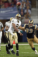 New Orleans quarterback Aaron Brooks (2) gets the pass off as Rams defensive end Brandon Green (93) closes in, during game action against St. Louis at the Edward Jones Dome in St. Louis, Missouri, October 23, 2005.  The Rams beat the Saints 28-17.